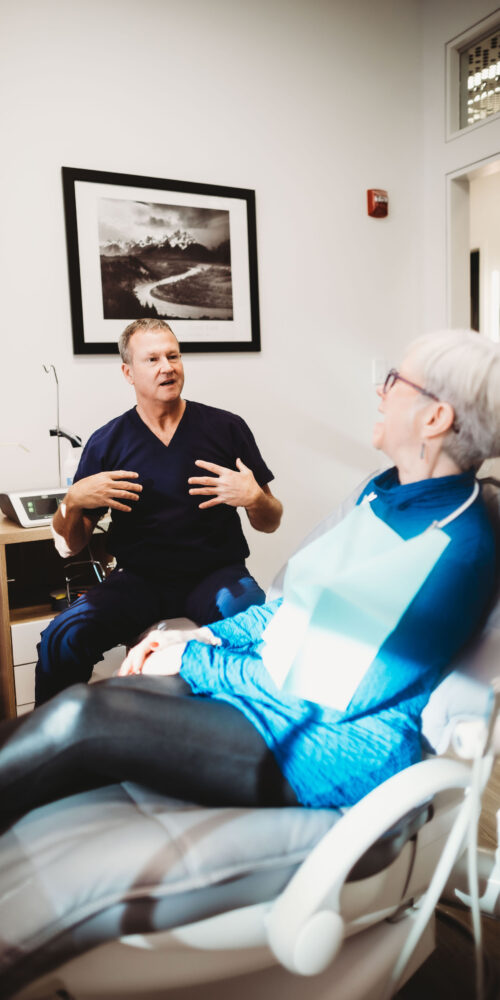 dentist discusses oral-systemic connection with patient